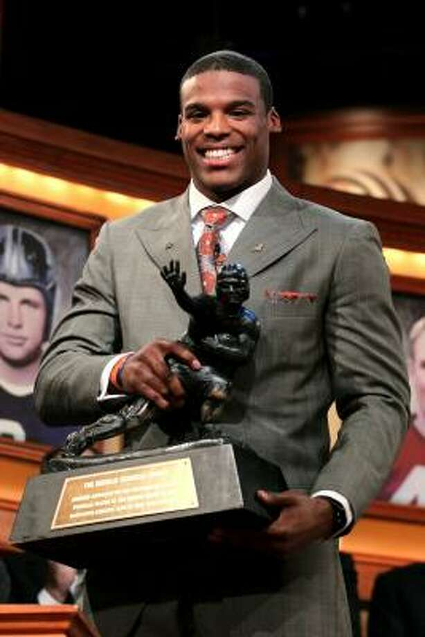 Auburn quarterback Cam Newton poses with the trophy after being named the 76th Heisman Memorial Trophy Award winner on Saturday night in New York City. Photo: Kelly Kline, Getty Images For The Heisman