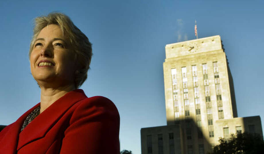 SOMETHING TO SAY: Houston Mayor Annise Parker stands in front of city hall. The new mayor has some ideas regarding the issues in the Heights, Neartown and Montrose neighborhoods. Photo: Brett Coomer, Houston Chronicle