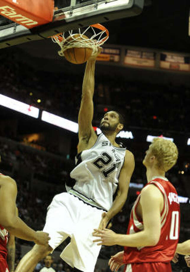 Spurs' Tim Duncan dunks in the second quarter. The loss dropped the Rockets back to .500 and one loss, or Spurs win, from officially being eliminated from playoff contention. Photo: BILLY CALZADA, SAN ANTONIO EXPRESS-NEWS
