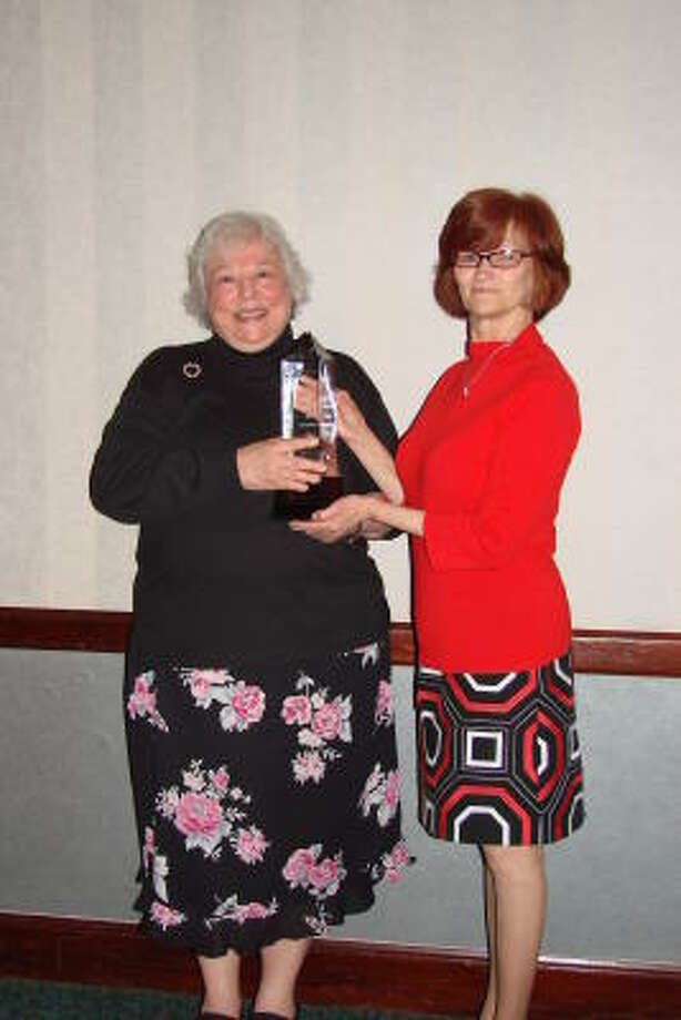 COURTESY PHOTO HONORED: Toby Myers, left, receives the Deedee Ostfeld Award from Janet Wilson, president of the board of directors for Aid to Victims of Domestic Abuse.