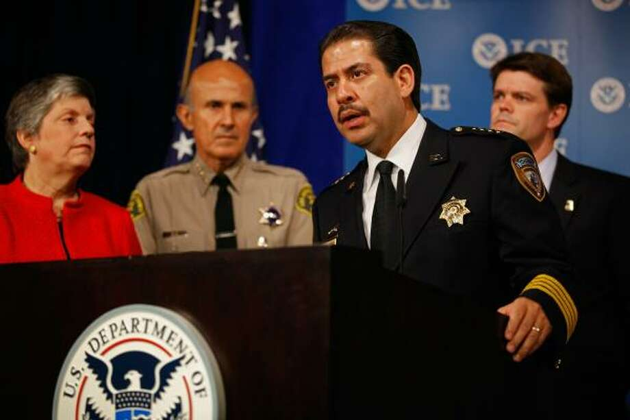Harris County Sheriff Adrian Garcia, with Homeland Security Secretary Janet Napolitano and others, lauds the Secure Communities program Wednesday at a news conference in Washington. Photo: Chip Somodevilla, Getty Images
