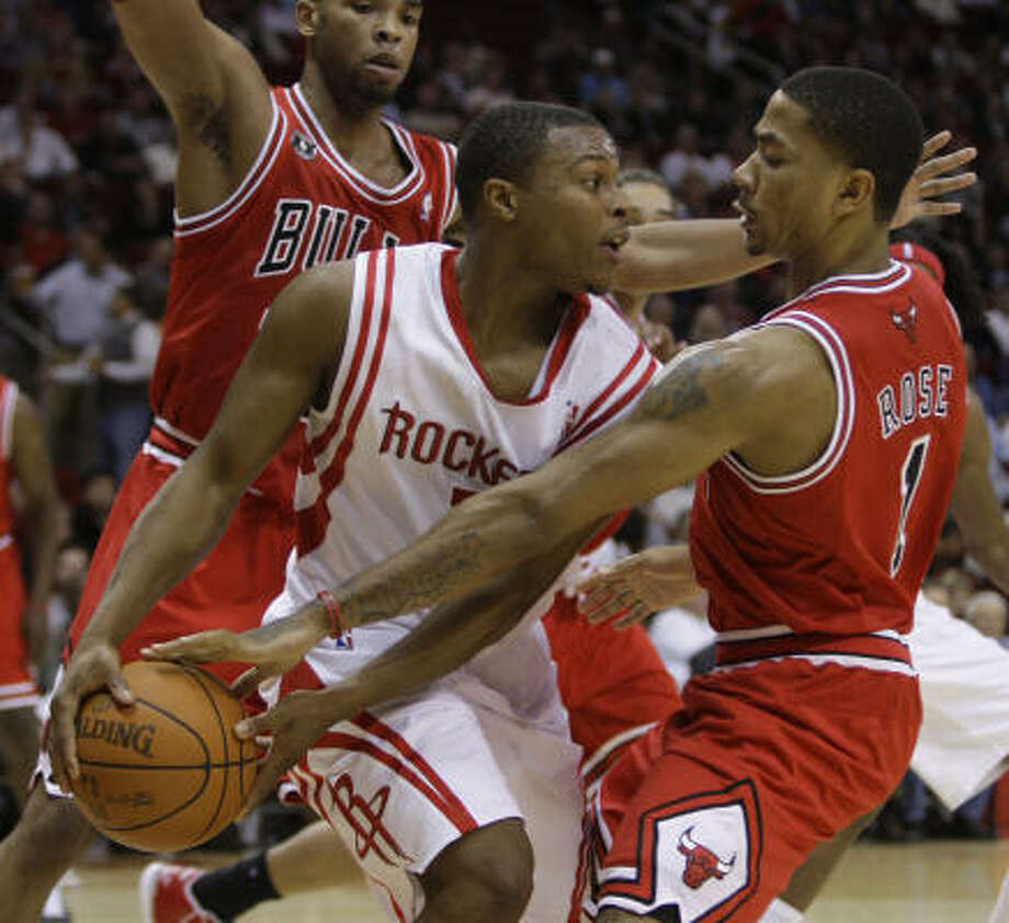 Chicago Bulls point guard Derrick Rose, right, is exactly the type of player the Rockets need, Richard Justice writes. Photo: Melissa Phillip, Chronicle
