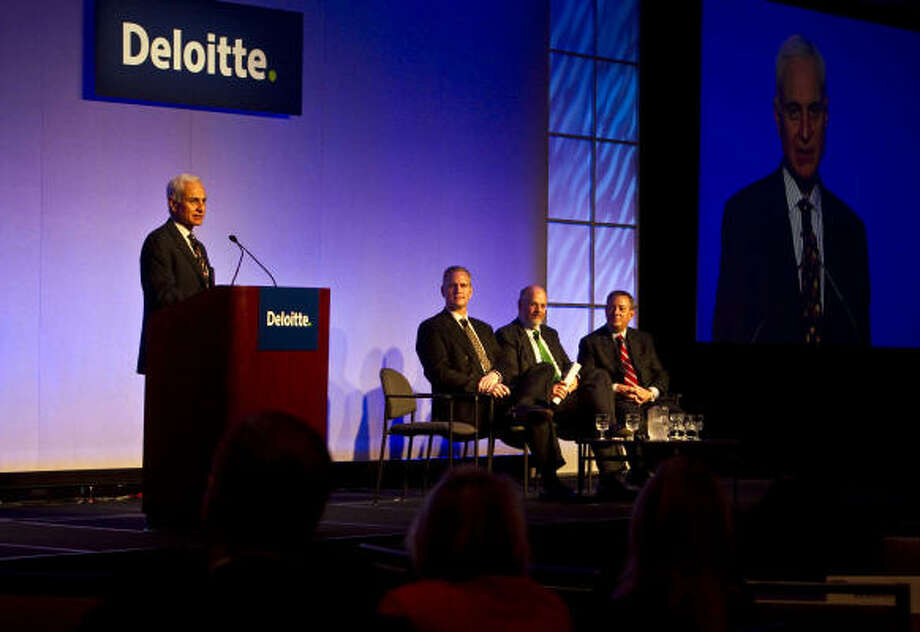 Sampat Prakash, left, principal at Deloitte Consulting LLP, addresses Deloitte's 2010 oil and gas conference. Other speakers at the energy conference included Mark Little, second from left, a senior vice president of Suncor Energy; Kevin O. Meyers, a senior vice president of ConocoPhillips; and Steve Kirchoff, a senior vice president  of Exxon Mobil. Photo: James Nielsen:, Chronicle