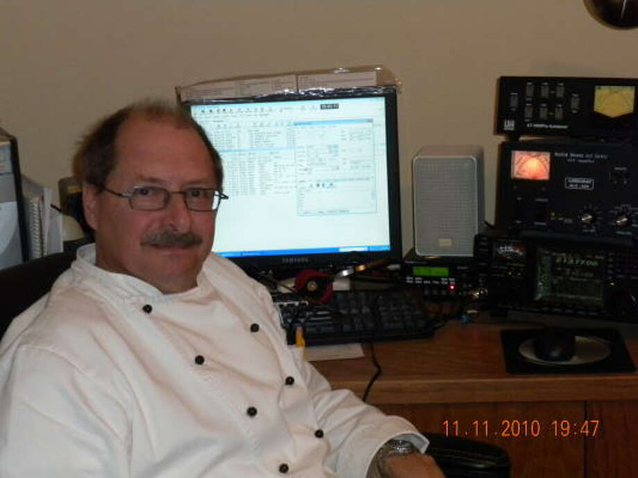 COURTESY PHOTO GLOBAL REACH: Leslie Bartosh spends much of his free time making contact with people all over the globe using his ham radio at home. Photo: ALL