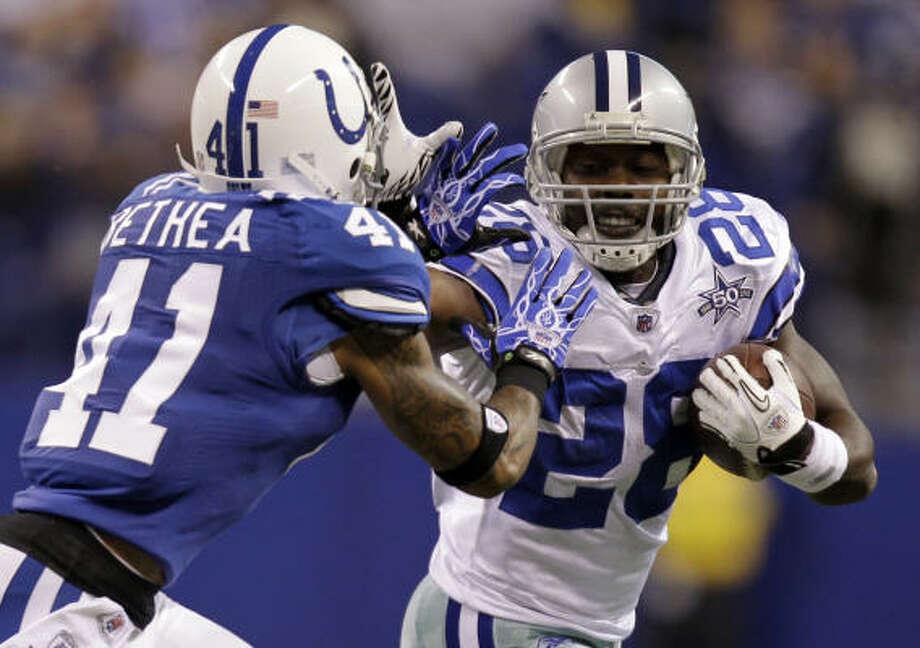 Cowboys running back Felix Jones pushes Colts safety Antoine Bethea. Photo: Michael Conroy, AP