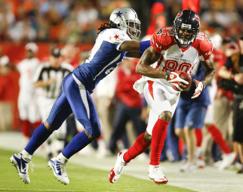 Texans wide receiver Andre Johnson (80) pulls in a pass from Matt Schaub. Photo: JOE RIMKUS JR., MCT