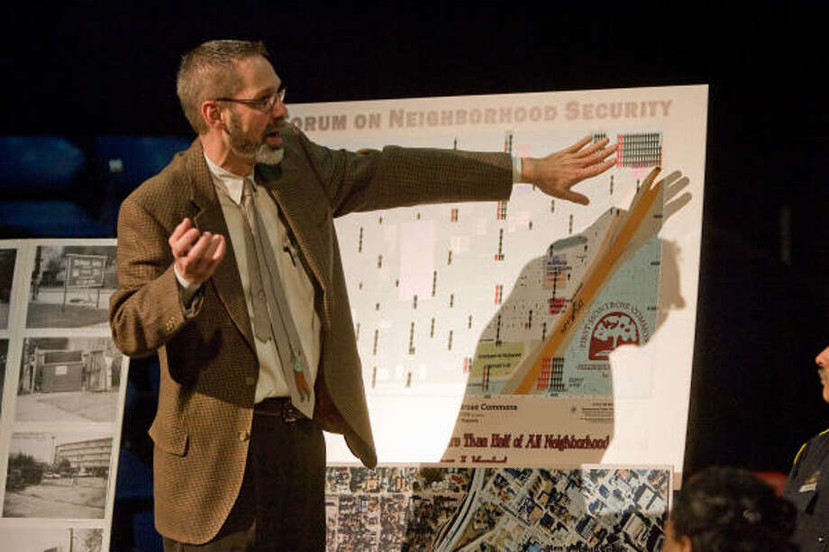 CRIME AREA: Steve Longmire points out an area on a map where residents are concerned about the amount of crime reports. Residents, city officials and Houston police discussed the problem at a neighborhood security meeting. Photo: R. Clayton McKee, For The Chronicle