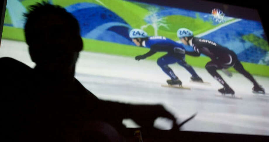 Brandon Sanford takes in the scene at Sawyer Park sports bar while watching the Winter Olympics. Photo: Billy Smith II, Chronicle