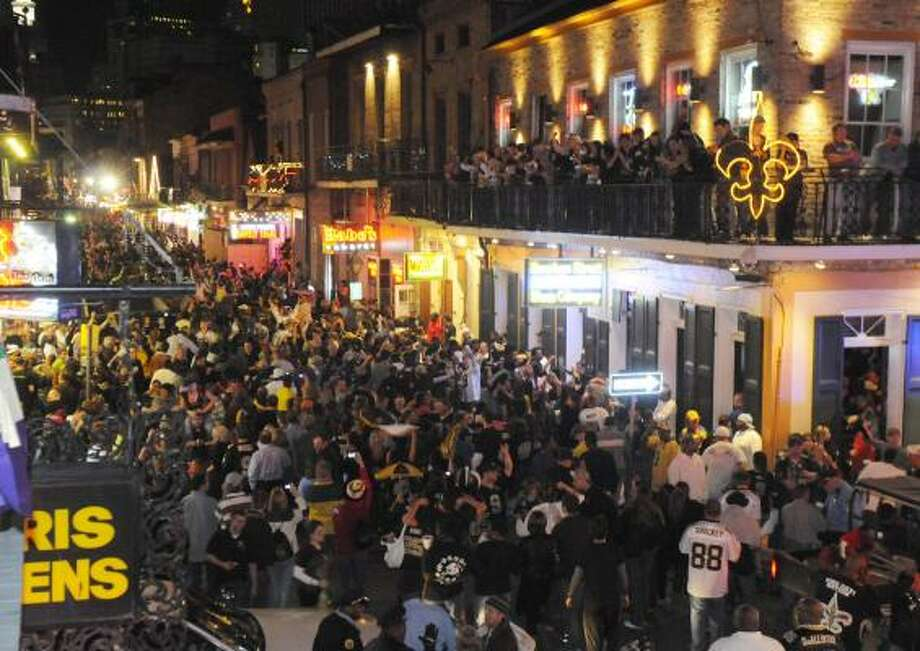 New Orleans Saints fans flock to Bourbon Street after the NFC championship game. Photo: Cheryl Gerber, AP