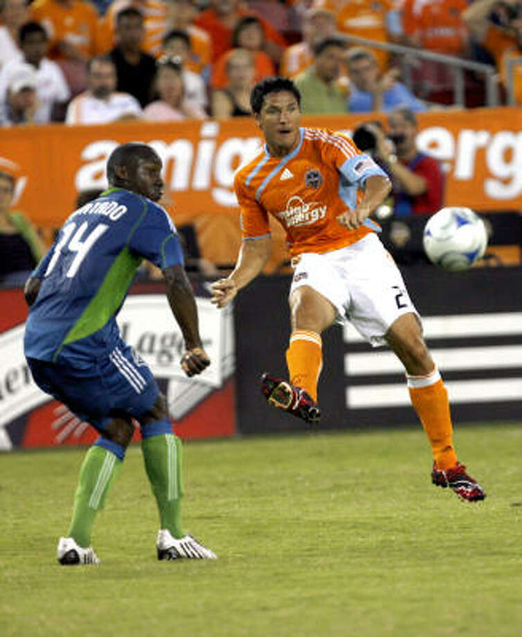 Dynamo forward Brian Ching, right, will learn today whether he made the 23-man roster for the U.S. World Cup team. Photo: Johnny Hanson, Chronicle
