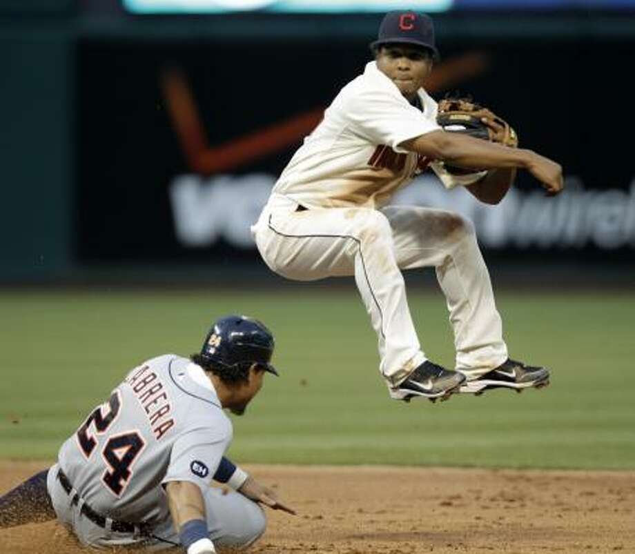 Indians shortstop Anderson Hernandez avoids the  Tigers' Miguel Cabrera after a force at second base on July 17. Photo: Mark Duncan, AP