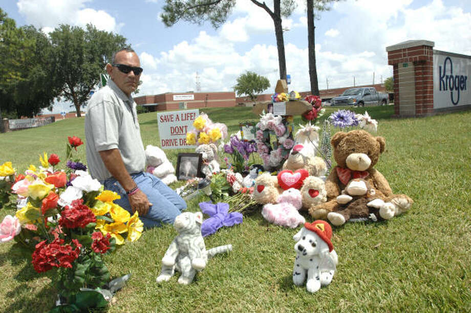 SPECIAL SITE: Mark Rodriguez visits the northeast corner of Texas 6 and West Road where his daughter was killed in an auto accident earlier this year. Photo: Eddy Matchette, FOR THE CHRONICLE