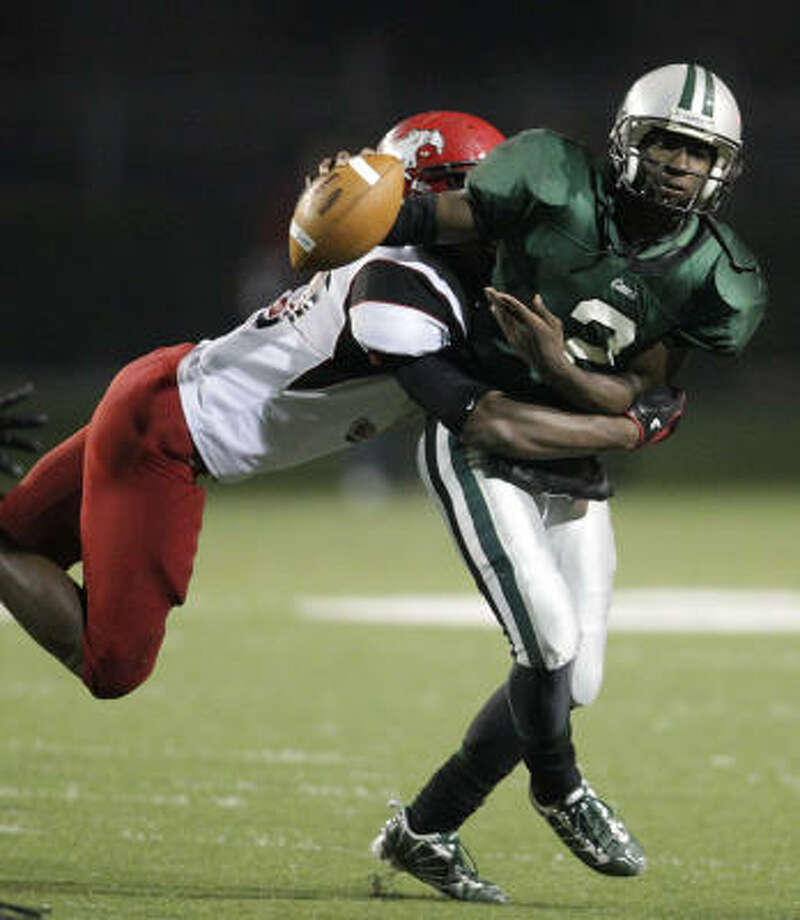 North Shore's Jarius Moore looks to tackle Hightower QB Bralon Addison during the second half on Friday. Photo: Karen Warren, Chronicle