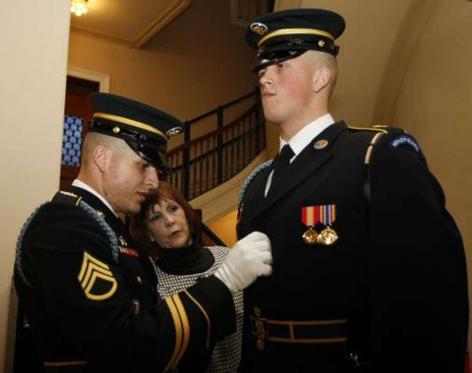 Staff Sgt. Jonathan Brisiel, left, and Spc. Mathew Brisiel attend Friday's ceremony with their mother at Fort Myer in Arlington, Va. It's the first time for brothers to earn the honor. Photo: Luis Alvarez, Associated Press