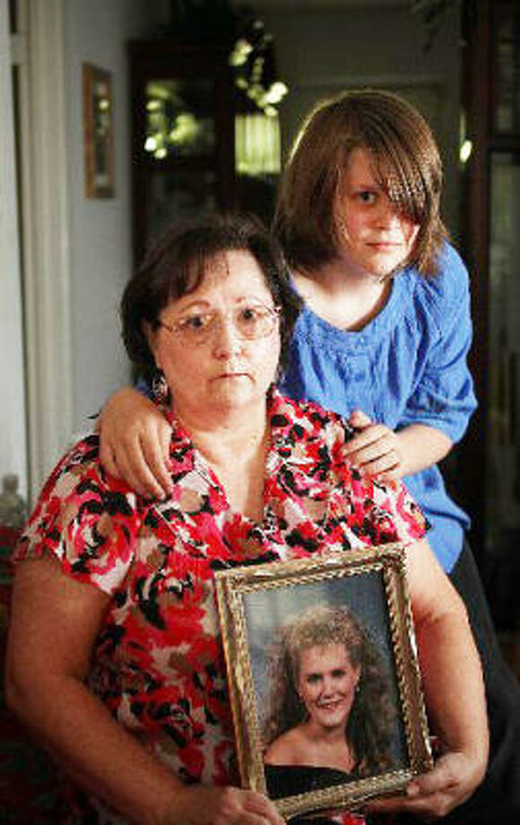 Janet Thompson, left, says her daughter, Stephanie Jones, shown in framed photograph, became addicted to drugs that finally killed her. Now Thompson is raising her granddaughter Rebecca Jones, 13. Photo: Mayra Beltran, Chronicle