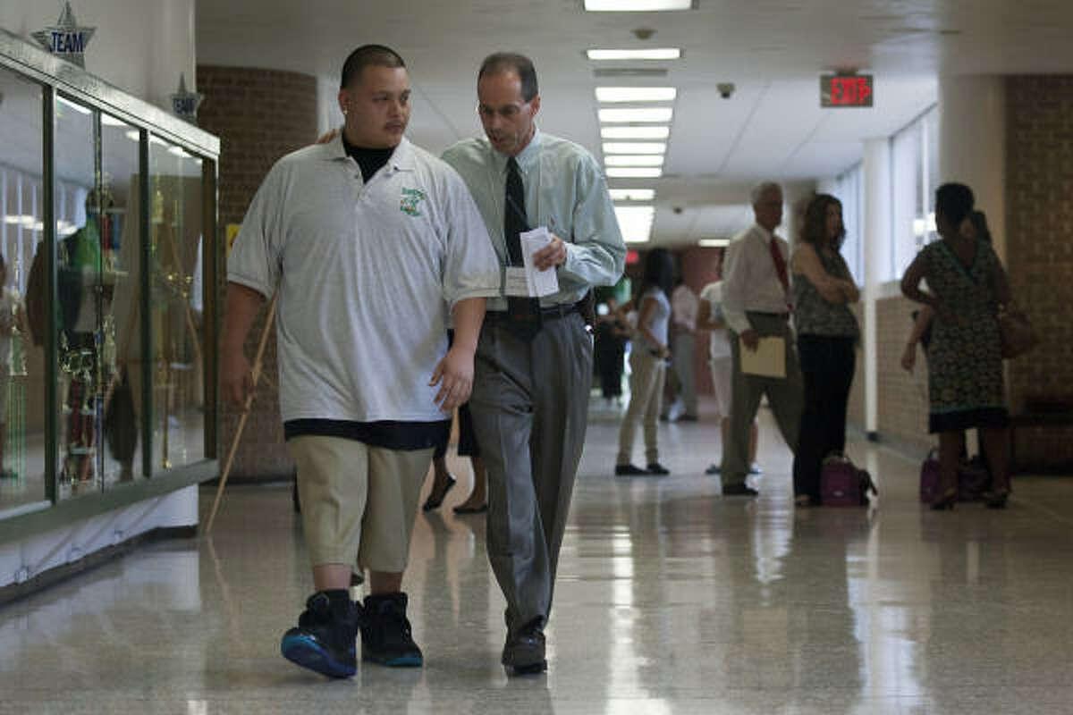 Principal Rob Gasparello welcomes Sharpstown High School senior Julio Teran to the Apollo program on Monday.