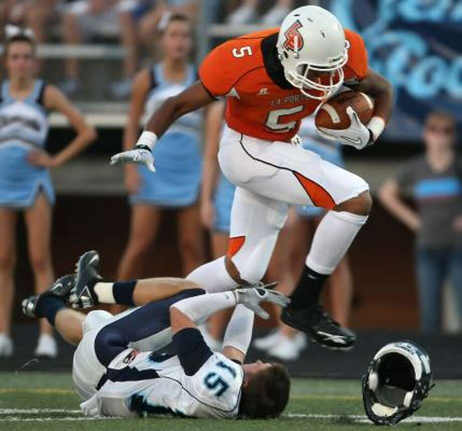 La Porte's Aaaron Nance-Garrett bowls over Clements' Brad Fontana on a 36-yard reception. Photo: ERIC CHRISTIAN SMITH, FOR THE CHRONICLE