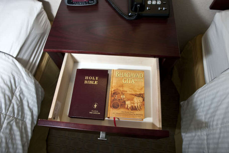 A Christian Bible and the Bhagavad Gita share space in a nightstand at the Best Western Windsor Suites in Houston. The nationwide motel Gita project has a goal of distributing 1 million copies of the text. Photo: James Nielsen, Chronicle