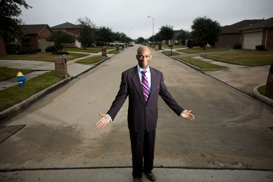 Pastor Kirbyjon Caldwell, who has a Wall Street background, is still building amid a real estate slump. This Corinthian Pointe street is part of Pointe 2.3.4. Photo: Eric Kayne, For The Chronicle