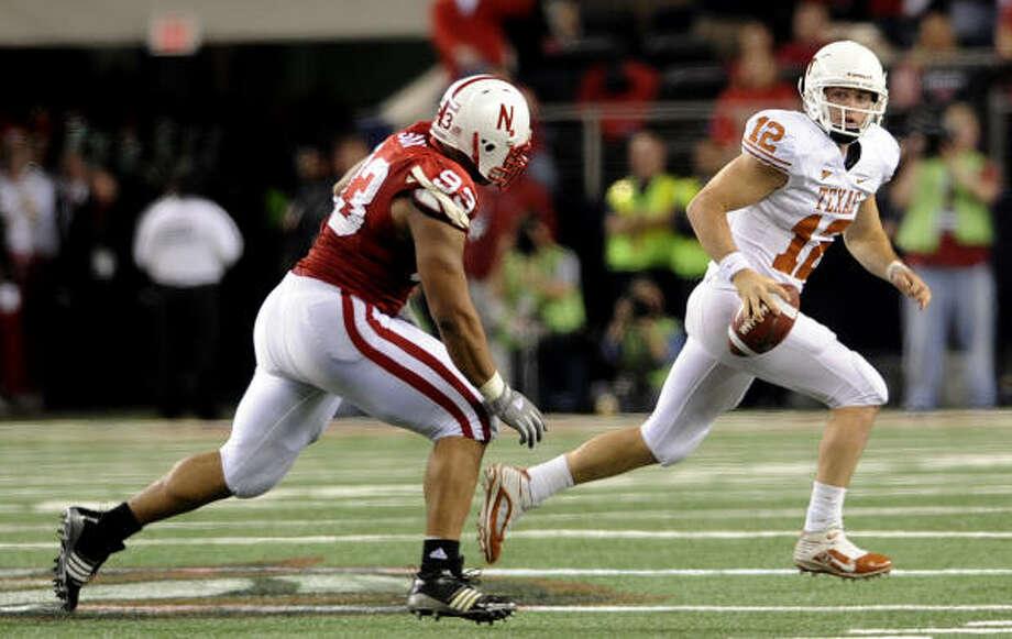 Texas quarterback Colt McCoy will have to run it some to keep Alabama defenders honest. Photo: BILLY CALZADA, San Antonio Express-News