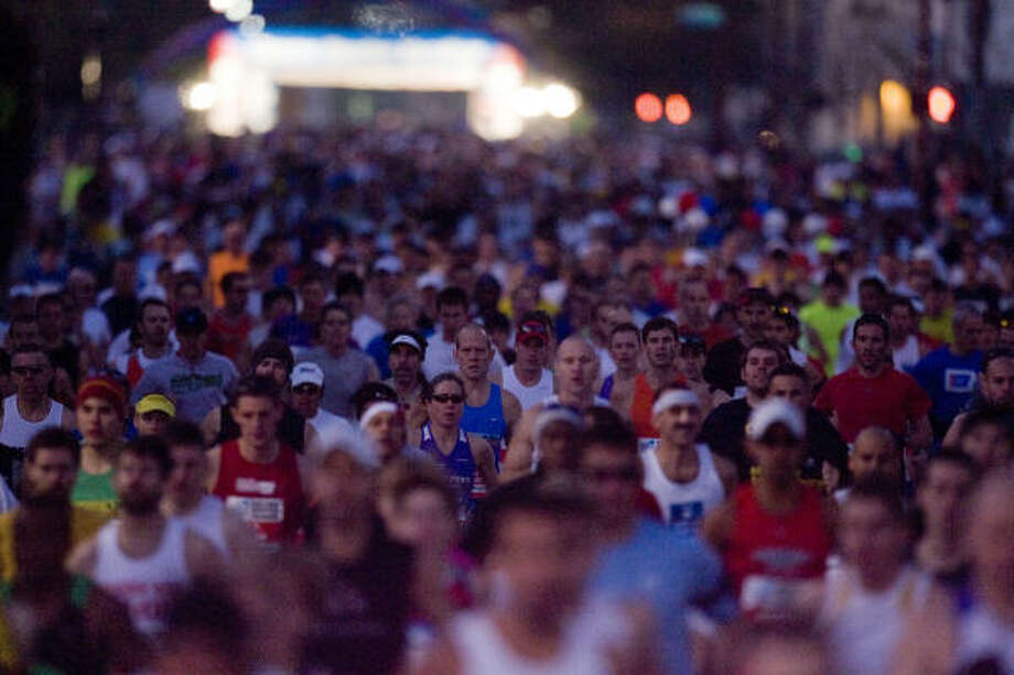 The start of Sunday's Chevron Houston Marathon saw a sea of runners — a record number in all events. Photo: James Nielsen, Chronicle
