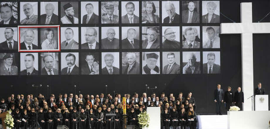 Relatives of the 96 victims of the plane crash that killed Poland's President Lech Kaczynski and other dignitaries attend a public memorial service on Saturday in Warsaw. Photo: JACEK TURCZYK, AFP/Getty Images