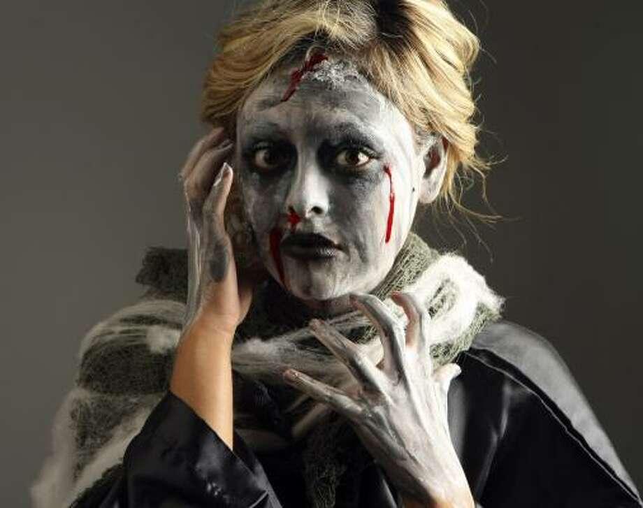 Model Jesseka Almanza looks ready to eat brains. Photo: HELEN L. MONTOYA, SAN ANTONIO EXPRESS-NEWS