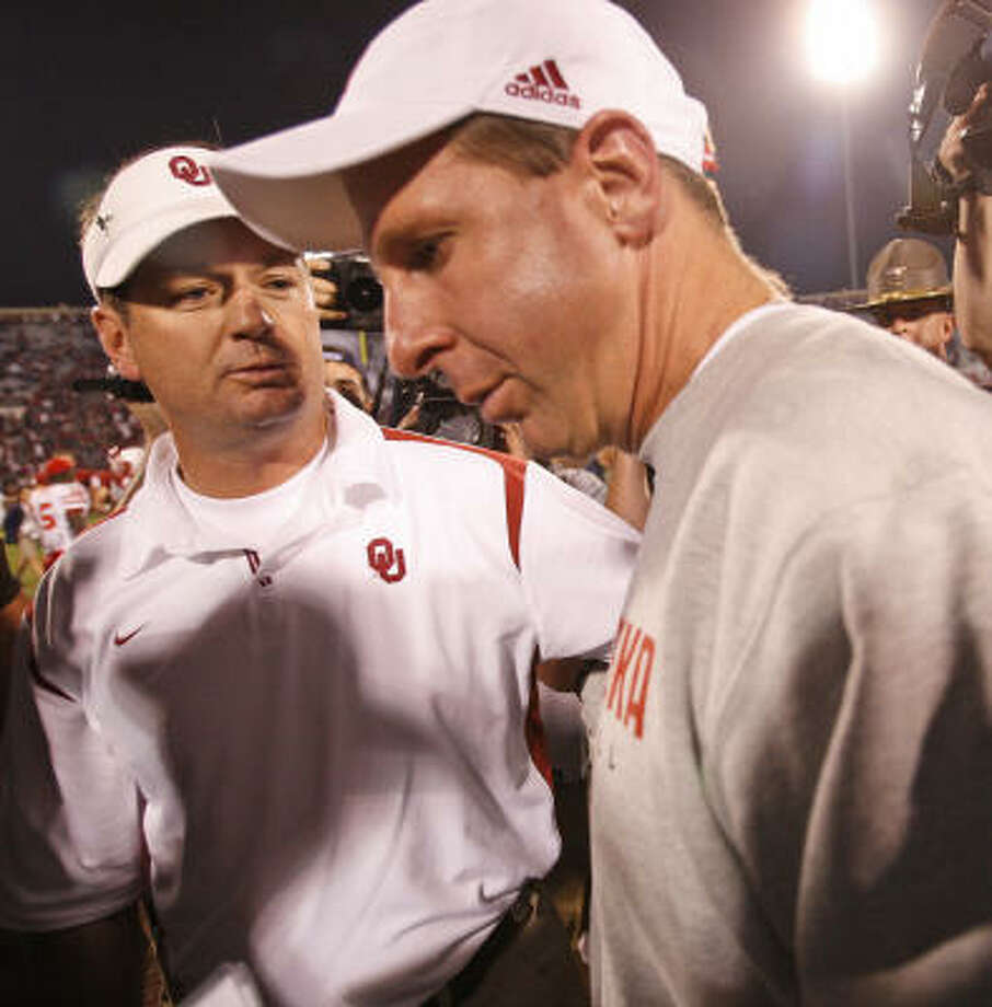Nebraska coach Bo Pelini, right, was in no mood for small talk with former colleague Bob Stoops after suffering a 62-28 loss to Oklahoma in 2008. But Pelini's turnaround of the program has put Nebraska in the Big 12 title game for the second consecutive year. Photo: Sue Ogrocki, ASSOCIATED PRESS