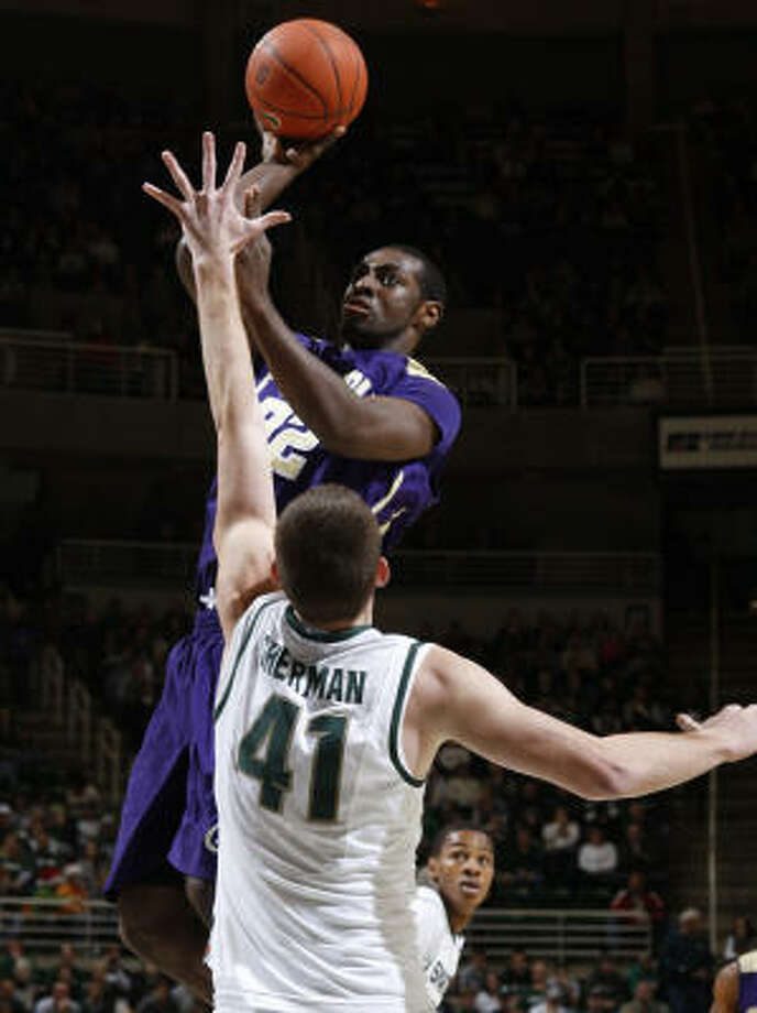 Prairie View A&M's Demondre Chapman shoots over Michigan State's Garrick Sherman (41) during the first half. Chapman scored 13 points in the loss. Photo: Al Goldis, AP