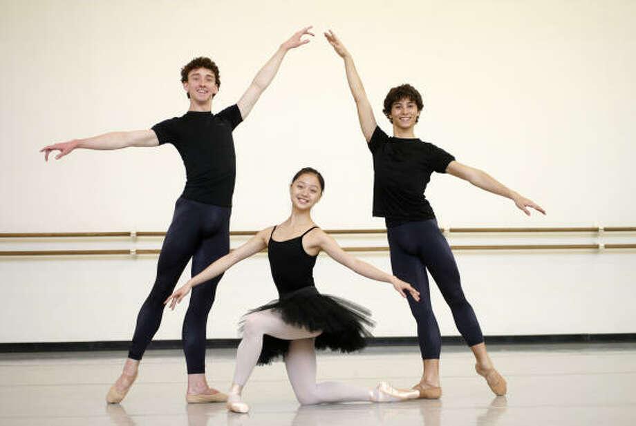 Aaron Sharratt, from left, Liao Xiang and Emanuel Amuchastegui are all Houston Ballet II students. Photo: Karen Warren, Chronicle
