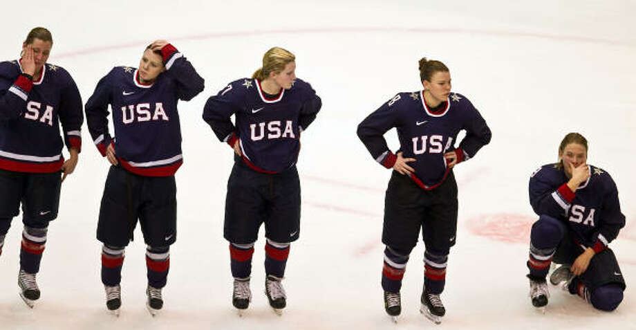 U.S. players wait to be presented with their silver medals after the 2-0 loss to Canada. Photo: Smiley N. Pool, Chronicle Olympic Bureau