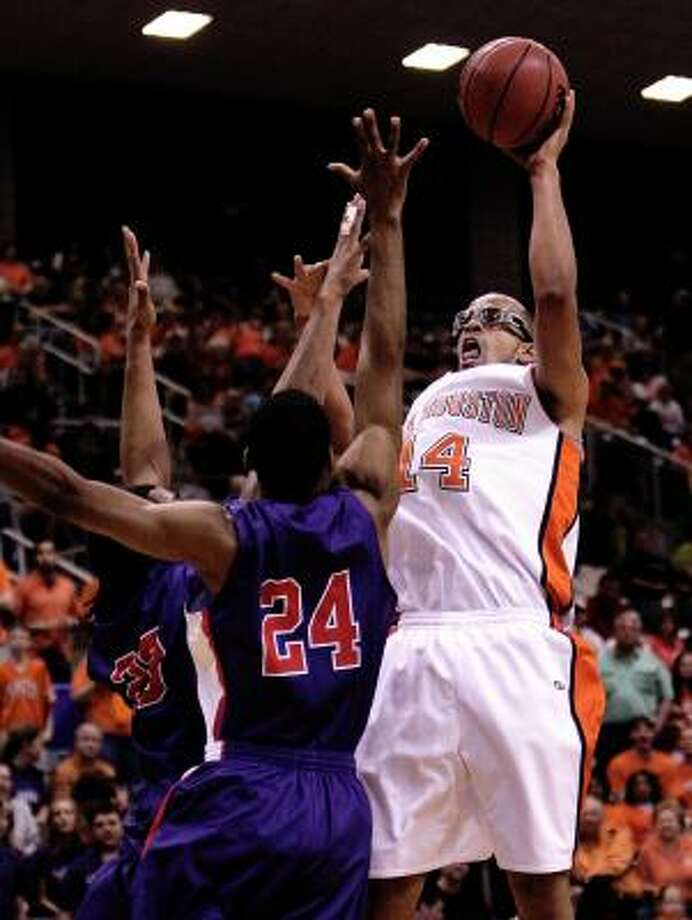 Gilberto Clavell, right, scored 21 points to lead Sam Houston State to a 64-48 win over SFA in Saturday's Southland Conference tournament championship game. Photo: Bob Levey, AP