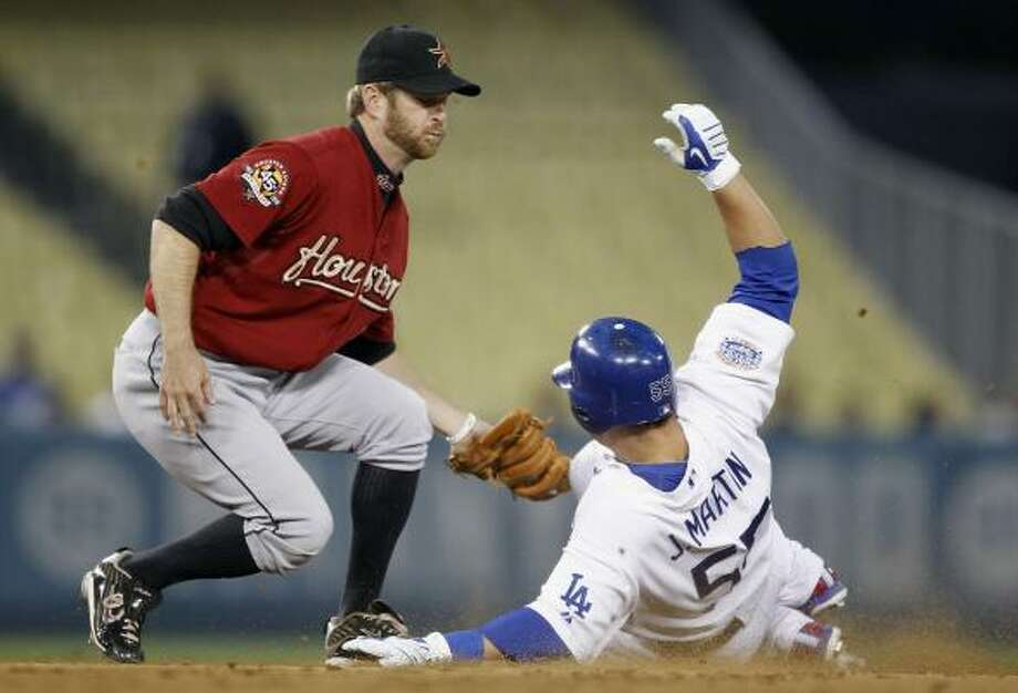 Astros second baseman Jeff Keppinger tags out Dodgers catcher Russell Martin on an attempted steal. Photo: Alex Gallardo, AP