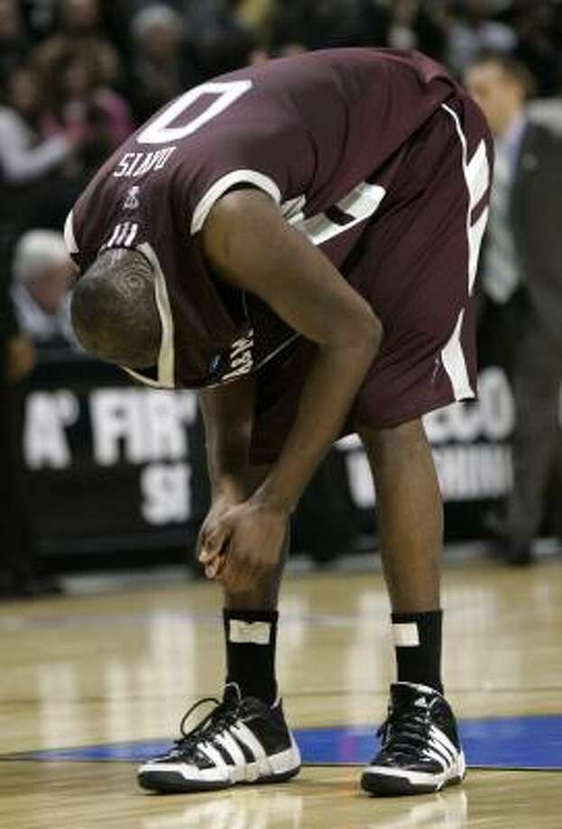 Texas A&M's Bryan Davis stands on the court after the loss to Purdue in overtime. Photo: Don Ryan, AP