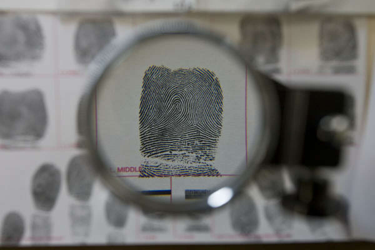 A sample at the HPD fingerprint unit is magnified. Thousands of cases from 2004 to 2009 have been reviewed.