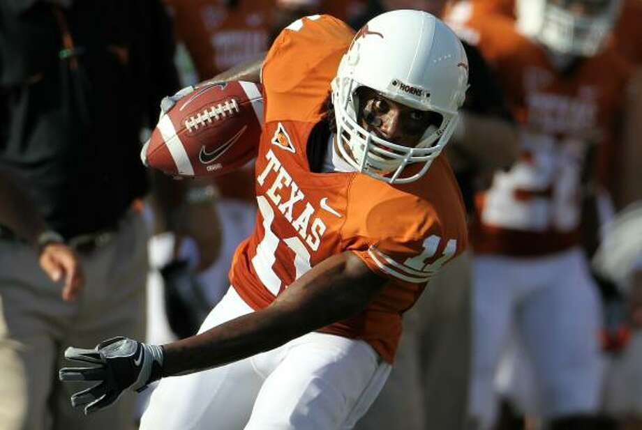Wide receiver James Kirkendoll and the Longhorns  look to tweak the offense before facing Oklahoma Saturday. Photo: Ronald Martinez, Getty Images