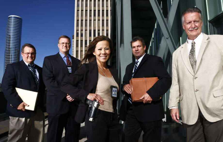 Houston Police Department homicide detectives Sgt. Michael Peters, left, Lt. Richard Kleczynski, Senior Officer Connie Park, Senior Officer Mark Kral and Sgt. Paul Motard are charged with solving more than 5,000 unsolved murders. Photo: Michael Paulsen, Chronicle
