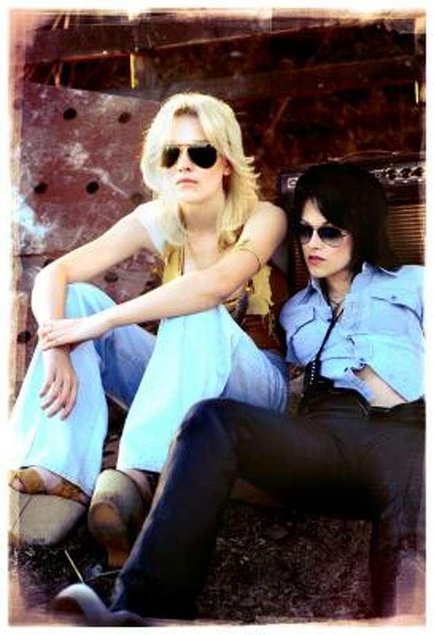 Dakota Fanning, left, stars as Cherie Currie, and and Kristen Stewart stars as Joan Jett in The Runaways. Photo: David Moir, Apparition Films | Associated Press