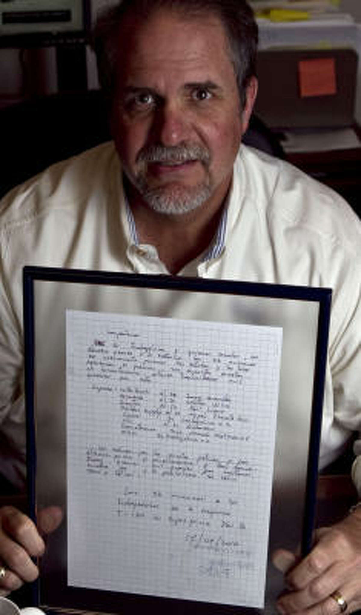 Driller Supply International President Greg Hall shows a Sept. 17 note from the 33 trapped Chilean miners.