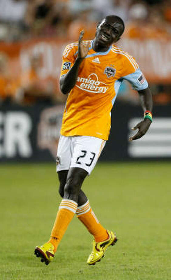 Dynamo forward Dominic Oduro doesn't look much like any of his teammates. Photo: Julio Cortez, Chronicle