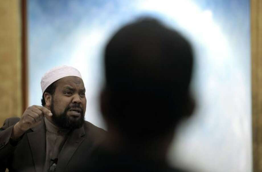 Imam Mohamed Magid says Muslim Americans need to establish a clear picture of what it means to be an American Muslim. As for majority-Muslim countries, he says Islam and democracy are quite compatible. Photo: ANDREW COUNCILL, NEW YORK TIMES FILE