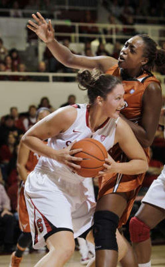 Texas' Ashley Gale, right, holds her ground against Stanford's Sarah Boothe on Sunday. Photo: Paul Sakuma, AP