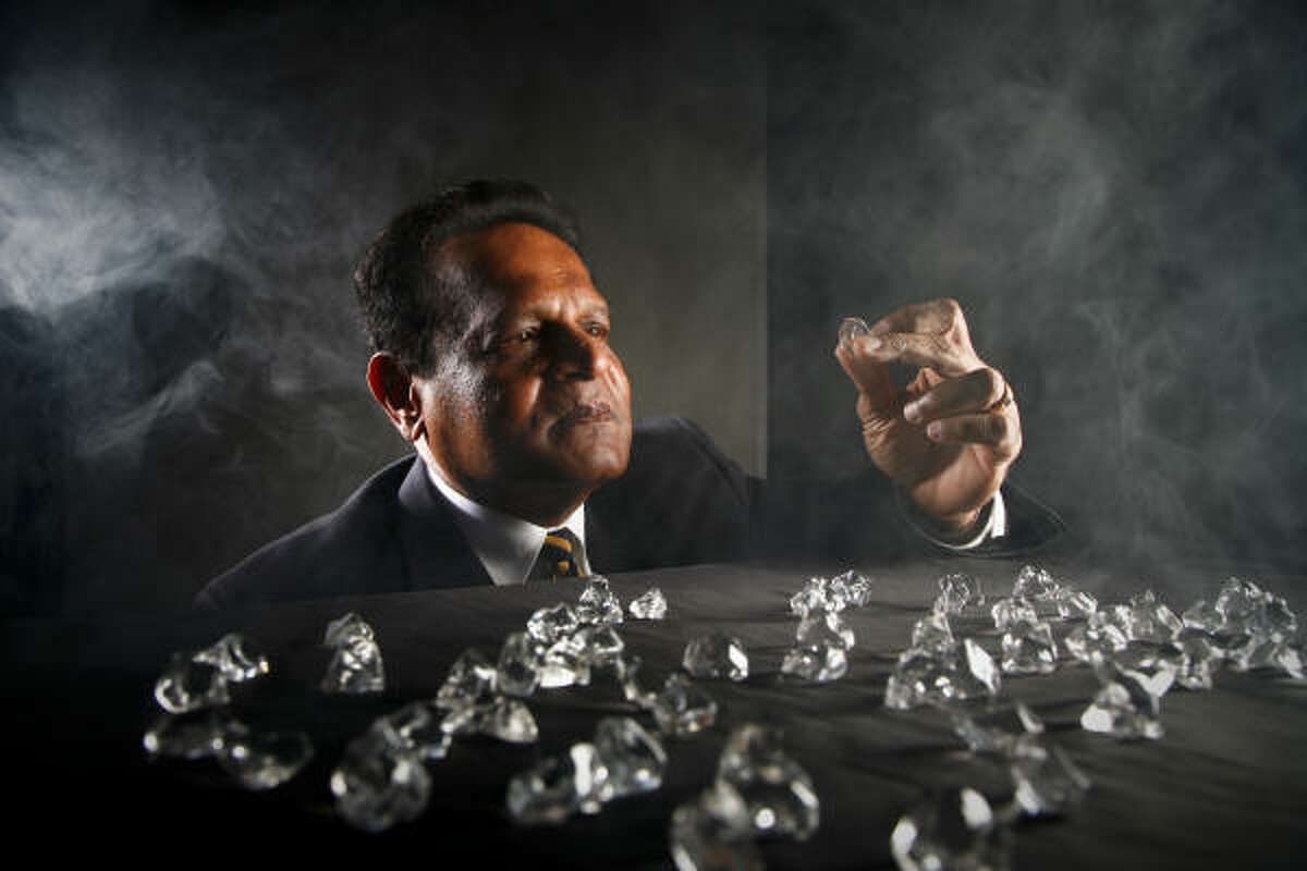 A studio shot incorporating ice cubes and fog dramatizes the work of Houston energy consultant Wickrema Singhe, one of numerous scientists seeking the key to unlocking natural gas from in icelike crystals called methane hydrates. They could hold as much energy as all the other fossil fuels combined, he says.