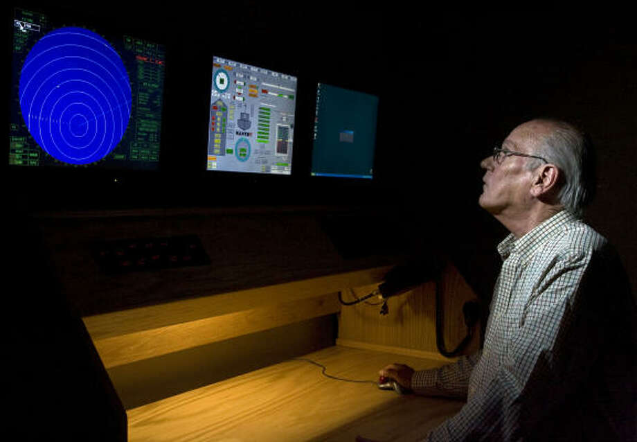"Texas A&M Galveston's Capt. R.L. Thrailkill demonstrates a radar simulator with radar, ship controls and Loran-C which is used to teach plotting at the campus. ""I'm an old salt, and I hate to see it go,"" he says. Photo: James Nielsen, Chronicle"