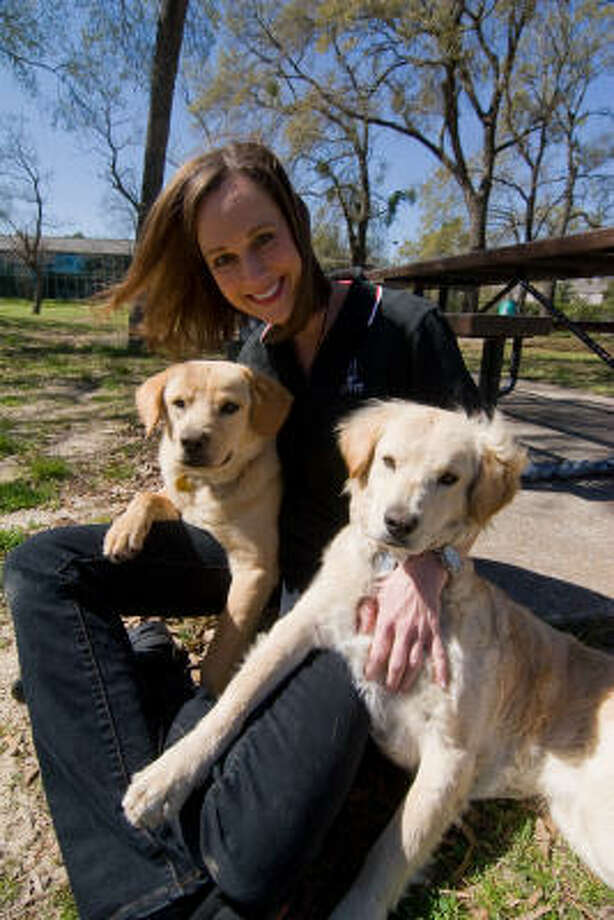 AMONG FRIENDS: Charlotte Liberda of Red Collar Rescue with two friends Mason and Monty. Liberda started the Red Collar Rescue in 2007. The nonprofit organization rescues dogs and tries to find them good homes. Photo: R. Clayton McKee, For The Chronicle