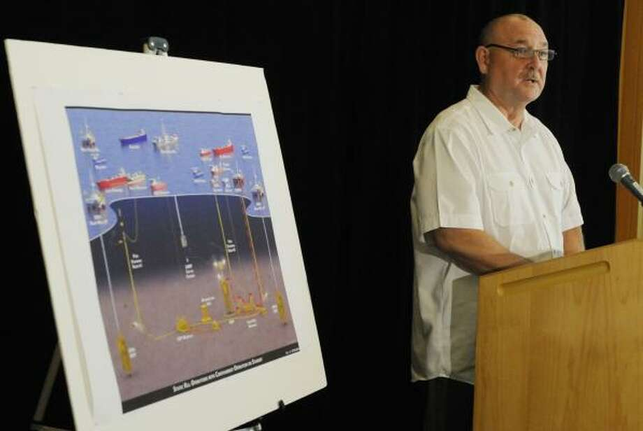 Retired Coast Guard Adm. Thad Allen gives an update on efforts to stop the oil spill in the Gulf of Mexico during a briefing at BP offices on Tuesday. He said the cleanup effort won't be done until the relief wells are completed. Photo: Pat Sullivan:, AP