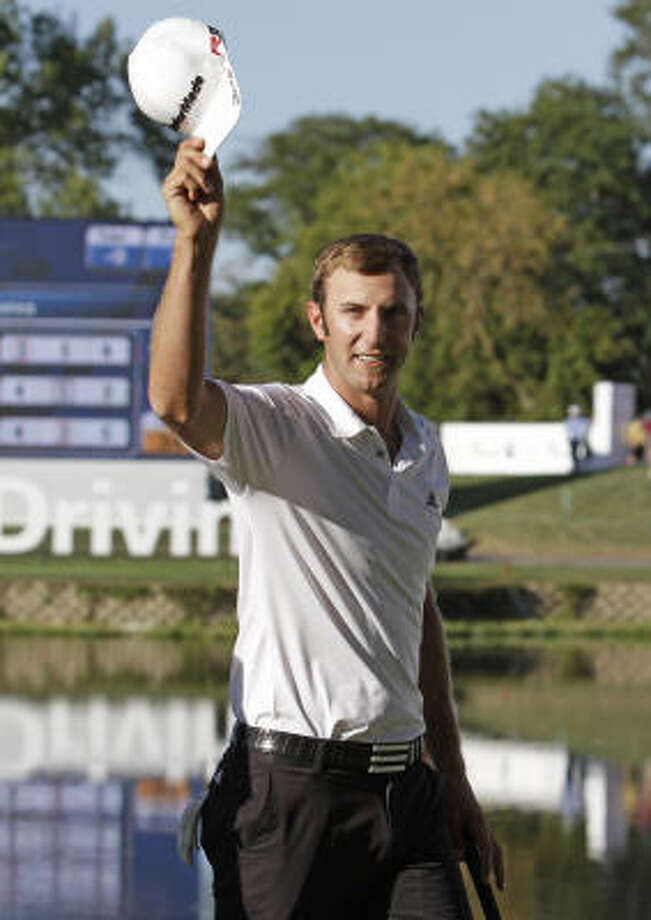 Dustin Johnson waves to the crowd after winning the BMW Championship on Sunday. Photo: Nam Y. Huh, AP