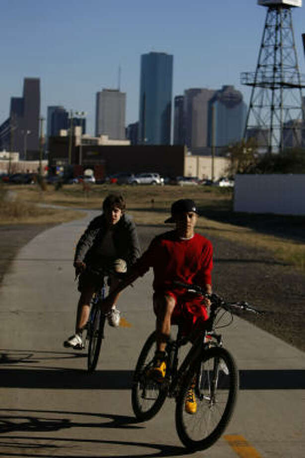 Houston Heights neighborhood residents Nick Milnarich, 14,afront to back, and Alex Dijak, 12, ride down a new stretch of bike trail that connected the Heights neighborhood to downtown near at Interstate 10 and Taylor St. Photo: Johnny Hanson, Chronicle