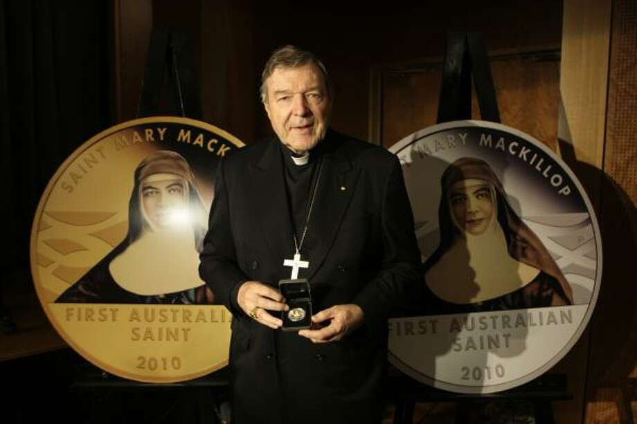 Cardinal George Pell holds Australia's first pure gold commemorative coin to honor Blessed Mary MacKillop in Sydney. Mary MacKillop, who co-founded the Sisters of St. Joseph of the Sacred Heart, will become Australia's first canonized saint Sunday. Photo: JEREMY PIPER, ASSOCIATED PRESS