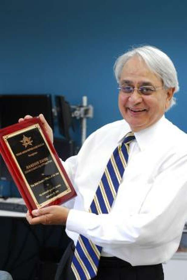 HARDWARE: Architect and former Piney Point Councilman Randhir Sahni shows off his Elected Official of the Year plaque at the Llewelyn-Davies Sahni architecture office. Photo: Tony Bullard, For The Chronicle
